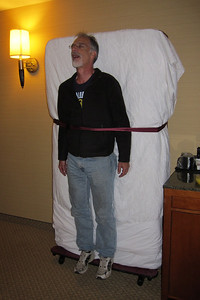 The hotel room was too small for crew to sleep horizontally, so Wayne made due.