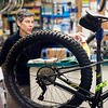 BEN GARVER — THE BERKSHIRE EAGLE<br /> Ken Gonsalves, bike mechanic at  the Arcadian Shop in Lenox,  grabs disinfectant after a mountain tune up, Friday, April 24, 2020. While retail for outdoor equipment is not open, bike service is considered essential. Non one is allowed into the shop, customers have to call in to drop off or pick up their bike, but Ken Gonsalves of the Acadian Shop says the bike repair is as busy as it would be under normal conditions. Store manager Chris Calvert notes that the staff is busy, but also reduced. Bike sales are possible via email and over the phone, but there are no test rides.