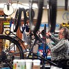 BEN GARVER — THE BERKSHIRE EAGLE<br /> Erik Forestell, bike mechanic at  the Arcadian Shop in Lenox, works on a road bike tune up, Friday, April 24, 2020. While retail for outdoor equipment is not open, bike service is considered essential. Non one is allowed into the shop, customers have to call in to drop off or pick up their bike, but Ken Gonsalves of the Acadian Shop says the bike repair is as busy as it would be under normal conditions. Store manager Chris Calvert notes that the staff is busy, but also reduced.
