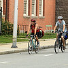 Trace Brady and Jack Cathcart ride onto Chruch St from Indiana