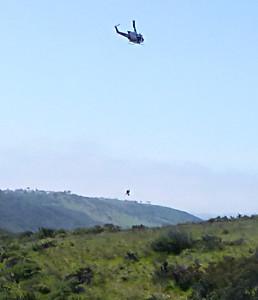 Mtn biker below helicopter