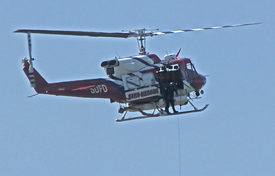 Letting out cable SDFD helicopter
