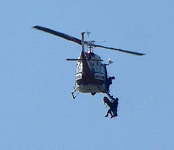 Mtn biker reeled up to helicopter
