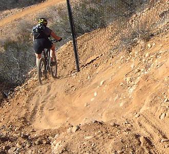 Jen rounding fence STR ride Penasquitos E 071124 crShrP1160629