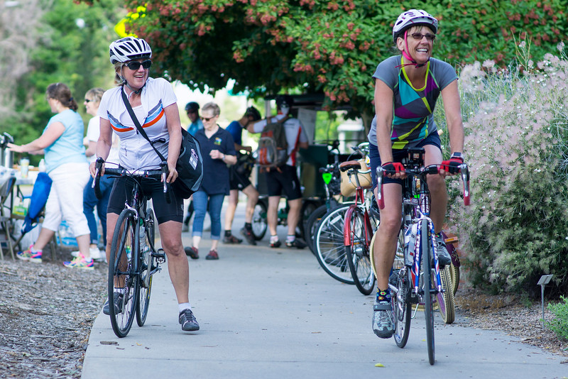 Cindy Catherman, left, and Lindsay Cantley stop at East First Street and Washington Avenue on their way to work during Bike to Work Day Wednesday June 22, 2016. Catherman rides her bike daily during her lunch breaks at work and Cantley rides leisurely since she works at home. <br /> <br /> Photo by Michael Ortiz/ Loveland Report-Herald