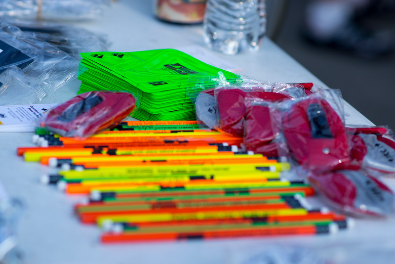 Different stops offered goodies and burritos to riders on their way to work Wednesday June 22, 2016. This included punch out reflectors for bikes and shoes, as well as wallet pouches and pencils for riders.<br /> <br /> Photo by Michael Ortiz/ Loveland Reporter-Herald
