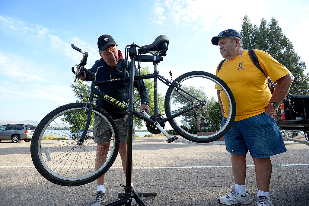 . Kirk Leamons, left, with Backyard Bicycles, adjusts Jim Haskin\'s bike Wednesday, June 28, 2017,  at the Bike to Work breakfast station at the southeast corner of Lake Loveland. (Photo by Jenny Sparks/Loveland Reporter-Herald)
