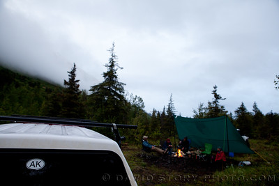2010 06 18: A tarp and a fire with friends fends off the drizzle and cool winds of Turnagain Pass, AK.