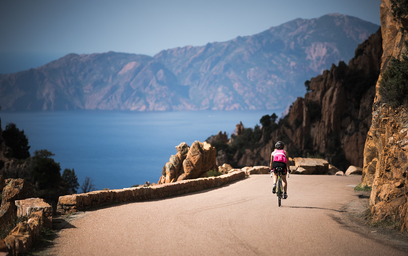 Valentine Fabre riding through the Calanques de Piana, Corsica, France