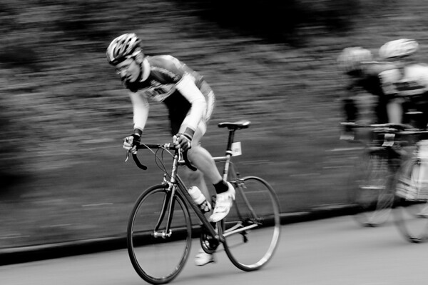 I managed to get the bars of the bike in focus on this one.  Odd effect for sure.  I love the motion blur in b&w!