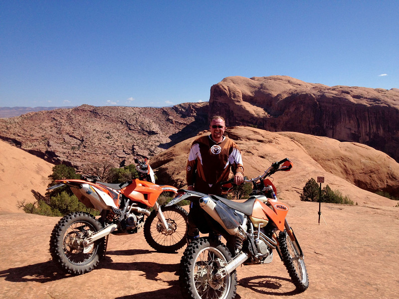 October 2012 on Poison Spider with Jim (at that DodgerDodger arch).  Found my engine leaking oil badly right there and high-tailed it back to the truck, and the Moab Brewery, from there.  Great day!