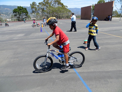 Principal on the blacktop to watch & help new riders