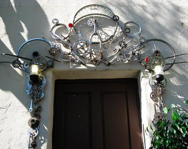 New art at Bici Centro (by Bay Area artist Mark Grieve)  http://www.markgrieve.com/SCULPTURE.html  Made a wheel arch in Ventura:  http://www.venturacountystar.com/news/2008/apr/04/artist-is-assembling-sculpture-out-of-bike-parts/  http://www2.cityofventura.net/enews/sota/issue6.asp