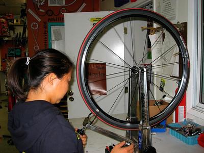 Janet truing her wheel