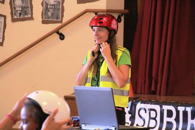 Jessica demonstrating proper helmet fit