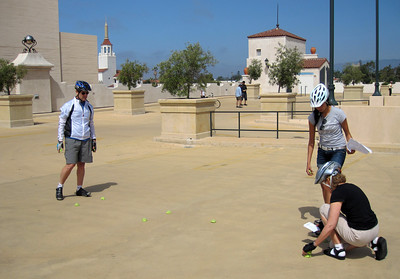 Setting up tennis balls for bike handling skills (Chris, Anji & Kevin)