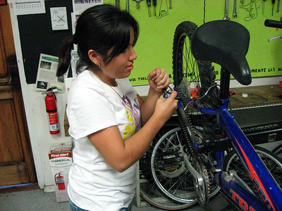 Diana is working on the brakes