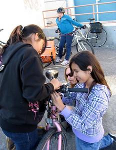 Girls installing a light on their bike
