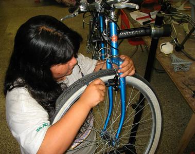 Lily is adjusting her brakes