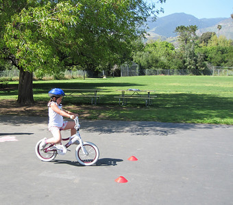 Participant who is using a bike as a skuup (not pedal). Great exercise for building confidence and balance.