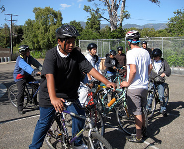 York is giving instructions to the Pedal Power participants before going for a neighborhood ride.