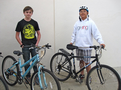 2 participants showing off their bikes