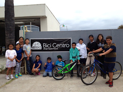 Group from the Santa Barbara School of Squash attending a Youth Earn-A-Bike program at Bici Centro