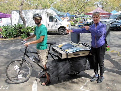 Jonathan with fully loaded Xtra Cycle (canopy, table, chair, display, maps...) He can carry it all.