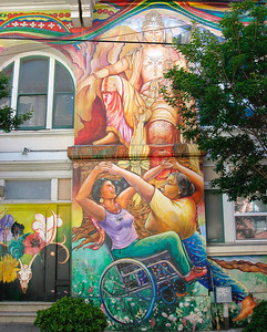 "The San Francisco Women's Building (located at 3543 18th Street at Lapidge Street) boasts two walls of a dramatic mural that pays homage to women. Created by a team of seven San Francisco women muralists, the ""Maestrapeace"" mural portrays women and feminine archetypes of multiple world origins. The Goddess of Light and Creativity adorns the top of the 18th Street facade with the waters of life flowing beneath her and transforming into fabric designs from around the world. The Mission District mural features such notable women as Georgia O'Keefe (an innovative American artist) and Rigoberta Menchu (a Guatemalan of Mayan decent and Nobel prize-winning activist). The names of many more famous women are inscribed in the mural's colorful patterns. The mural is meant to be inspiration and educational, illustrating the contributions women have made to human history and society.  http://womensbuilding.org/content/"