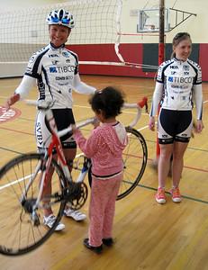 Kids are lifting the carbon fiber bike.