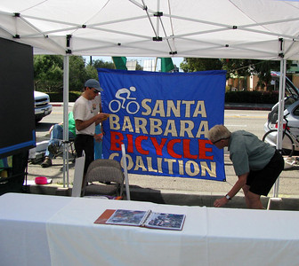 Ralph Fertig and Dave Bourgeois are setting up the booth for the Santa Barbara Bicycle Coalition & Bici Centro www.sbbike.org www.bicicentro.org