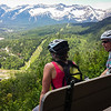 Top of the ride - Kim and Maddie contemplating the slog up, and the awesome singletrack descent awaiting them on Swine Flu