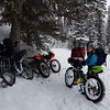 Snack break by the first bridge on Goat Creek. A pause in the snow! Photo courtesy of Guy S.