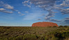 Thursday 15th May 2014 5:15PM: Late afternoon shot of Uluru (Ayers Rock), within the Uluru-Kata Tjuta National Park (an UNESCO World Heritage site). The Anangu people (Pitjantjatjara Aborigines) are the traditional Aboriginal owners. The rock was created over some 600 million years. It is 348m above ground, and about 2.5kms of its bulk is underground! Uluru lies west of the Simpson Desert, about 335kms southwest of Alice Springs (as the crow flies) and 463kms by road. The rock is about 3.6kms long and 1.9kms wide, with a circumference of 9.4kms, and covers 3.33 km2. It is is 348 metres high and rises 863 metres above sea level The climb to the top is 1.6kms, and the summit is generally flat. The surface is made up of valleys, ridges, caves and weird shapes that were created through erosion over millions of years. Surface oxidation of its iron content gives the would-be grey Uluru a striking orange-red hue.