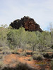 Friday 16th May 2014 12:30PM - Photo taken by Sue: This is Corroboree Rock (42km east of Alice Springs). It is an outstanding dark grey column of dolomite that's of great importance to the Eastern Arrernte Aboriginal people of the region. However, it's doubtful that it was ever used as a corroboree site, due to the lack of water in the area; but it was probably used as an important storage site for ceremonial objects.