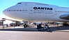"""Wednesday 7th May 2014 10:30AM: On the road to Alice Springs! At Longreach Airport: A photo of the Wing, and another machine with wings!  :-)  This old (1979) Qantas 747 is open to the public, and is part of the """"Qantas Founders Outback Museum""""."""