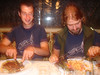 Dave and Alex enjoy their meals and matching tshirts