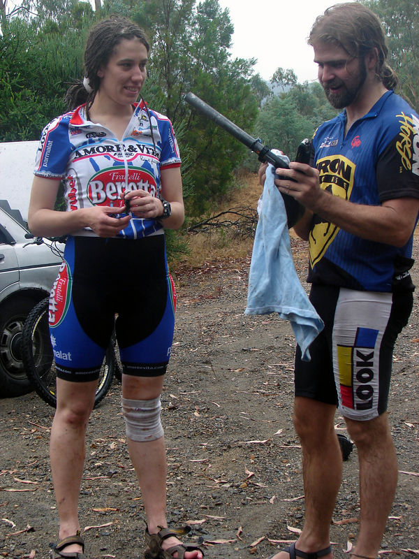 Elise(?) and Alex in fancy matching bike clothes, contemplating bike pumps before we head out.