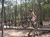 Justin rides over the seesaw, part of the crosscountry trail