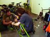 Corey and Shaggy playing with my back wheel.  The new house is a bike workshop