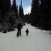 <b>22 March 2013</b>  Snow biking Goat Creek - Finn running the trail