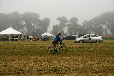 Taken from our site -- the closest white shelter is the registration tent.  The guy in blue is my friend Justin, on his new bike.  He, his girlfriend Amy, and Mychau would be doing a shorter, easier 40-mile ride that started a couple of hours after mine.