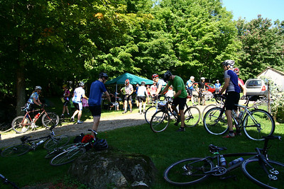 "This is the first checkpoint/support station.  You got your card marked at the check-in desk, then grabbed food and water and used the porta-john, if you needed it.  This first checkpoint came about 12 miles into the ride.  I'd already done about as much climbing at this point as I've ever before done in a single ride -- even rides up to 130 miles in length.  Shortly before this checkpoint you topped one of the many long grueling climbs to find a guy standing in his front yard, playing a bagpipe for the passing riders.  Awesome.  I croaked to the riders around me at that point, ""Is that my [gasp] funeral?"""