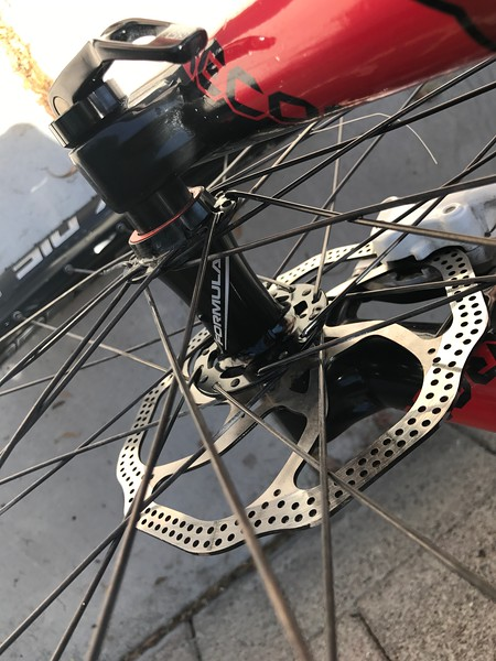 """Wheels are Sun Ringle Inferno 25 with Formula hubs (I removed the stickers from the rims). These are not tubeless wheels, but I've been running them tubeless ever since I got the bike without issue. Tires are 2.4"""" Schwalbe Nobby Nic (installed Summer 2016)."""