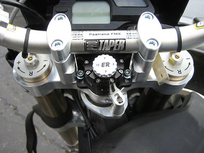 Billet upper and lower triple clamps accommodate an underbar damper and bar risers. Gary Emig makes very nice stuff.