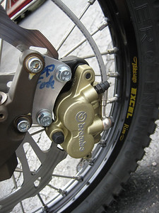 Caliper hanger plate to accommodate the BMW Brembo caliper and rotor on the Husky/Zoke fork leg.