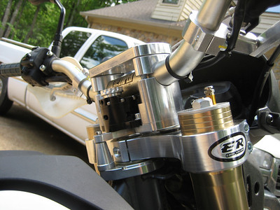 Emig damper and post, risers, triple clamp, and GPS mount plate.