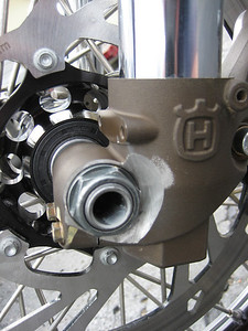 This is a modified billet RAD hub for a KTM. The fork lug was relived so the BMW axle and nut could be used with a typical box end wrench. Special wheel and lug spacers had to be made to make the BMW Axle work with the Husky forks. The BMW fork spacing is very wide.