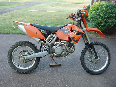 2005 KTM 450EXC. This is how it was when I bought it. Ran fine. every bearing in the chassis was trashed. There was water emulsified in the fork oil! Seller kept the steering damper.   Lotsa work to do to this one.