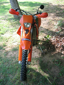 For the woods, it's this beast if I'm feelin' lazy, or the Husky WR250 if I'm feeling tough. Ride orange or ride blue/yella. Pick your poison.